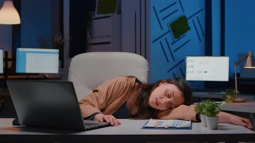 Businesswoman Sleeping While Working at Accounting Statistics in Company Office