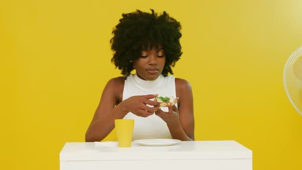 Black Woman Is Eating Pizza Arugula