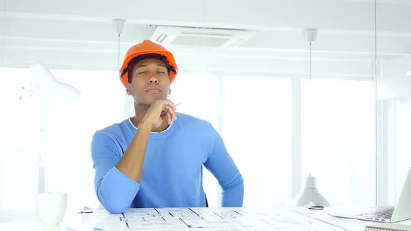 Cover Image for Architectural Engineer Working on Blueprint in His Office