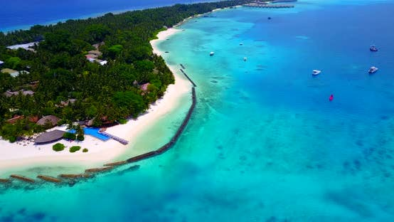 Thumbnail for Natural fly over travel shot of a sunshine white sandy paradise beach and aqua blue water background