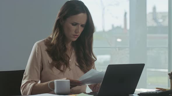 Thumbnail for Business Woman Working with Papers. Professional Worker Looking Problems