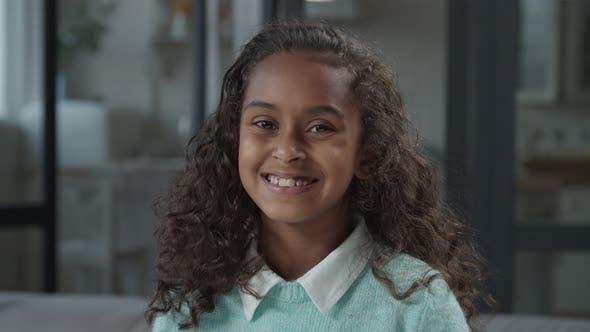 Cute Preadolescent African Girl Smiling Indoors