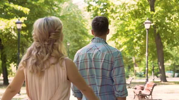 Thumbnail for Loving Couple Gently Embracing, Enjoying Long-Awaited Date in Park, First Love