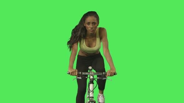 Female exercising on bicycle