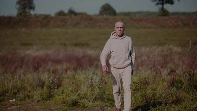 Senior Man in Sportswear Walking Outdoors