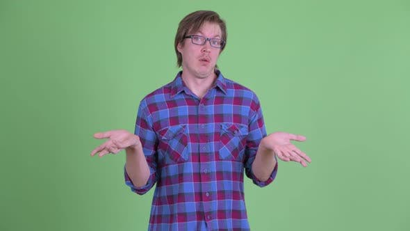 Cover Image for Stressed Young Hipster Man Shrugging Shoulders