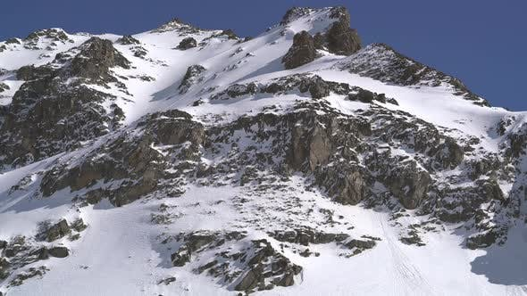 Thumbnail for Just Below the Mixed Snowy and Rocky Summit
