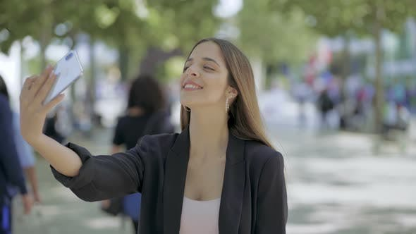 Thumbnail for Attractive Girl Taking Selfie with Smartphone Outdoor