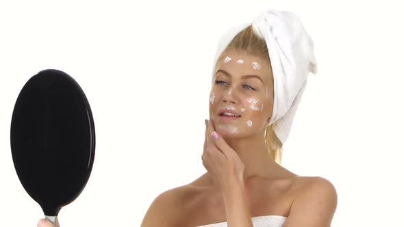Thumbnail for Smiling Beautiful Young Woman Applying Face Cream, Bathroom