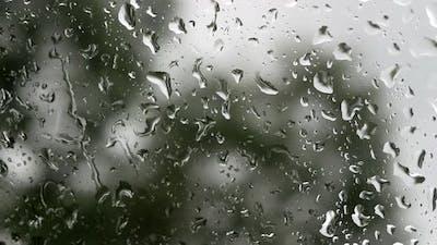 Close-Up Of Rain On A Car Window