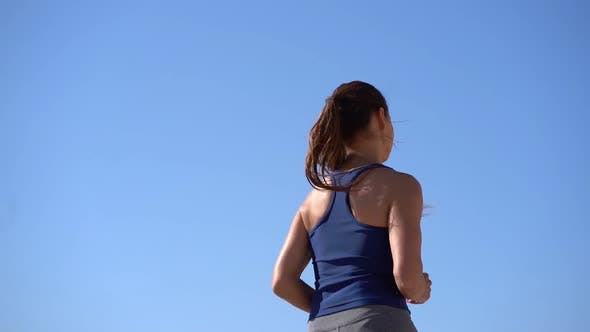 Thumbnail for Back View of Sporty Girl Jogging at Sunny Day
