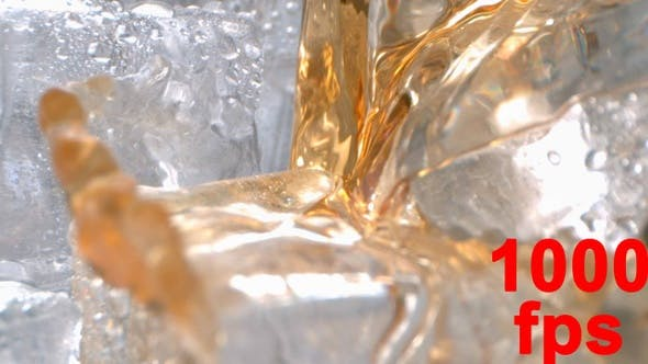 Cover Image for Alcohol Liquor Drink Is Pouring Onto Ice In A Glass In High Speed
