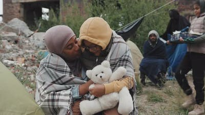 African American Mother and Daughter at Refugee Camp