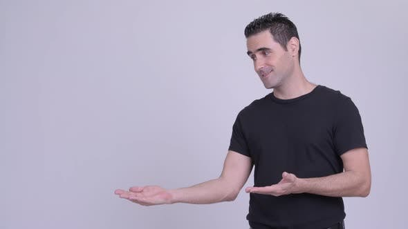 Thumbnail for Happy Handsome Man Showing Something Against White Background