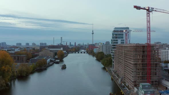 Thumbnail for Spree River with Berlin Cityscape and Construction Site on the Riverside, Aerial Wide Angle Forward