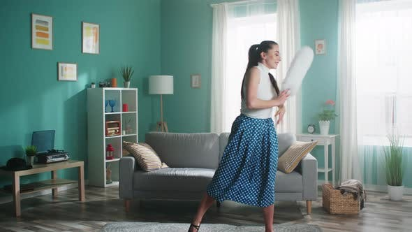 Young Woman Is Performing with Cleaning Brush at Home