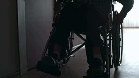 Thumbnail for Silhouette of Male Patient Riding Wheelchair