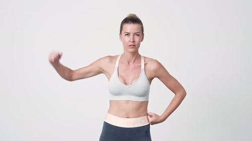 Sportswoman Flexing Arms To Camera