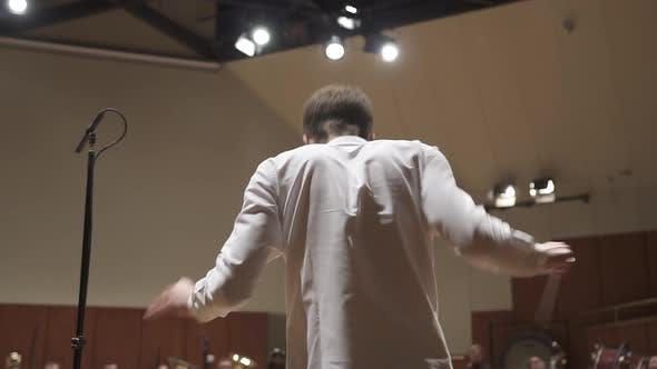 Conductor from behind