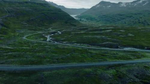 Drone Shot of Epic Winding Road in Iceland Fjord