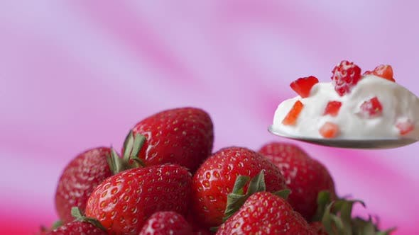 Thumbnail for Strawberry Yogurt in a Spoon, Against the Background of Fresh Strawberries