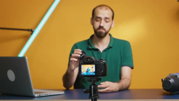 Thumbnail for Expert in Photography Equipment Reviewing Lens