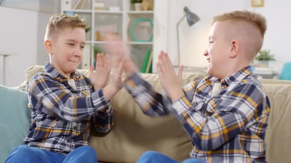 Thumbnail for Twin Brothers Playing Clapping Game at Home