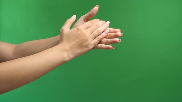 Woman Clapping Hands On Green Screen Background