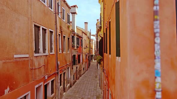 Deserted Cobblestone Sidewalk Between Terracotta Buildings