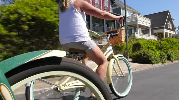 Thumbnail for Woman riding bicycle in coastal vacation community
