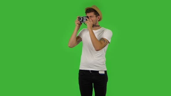 Thumbnail for Tourist in Hat on Vacation Takes Pictures on a Retro Camera. Green Screen