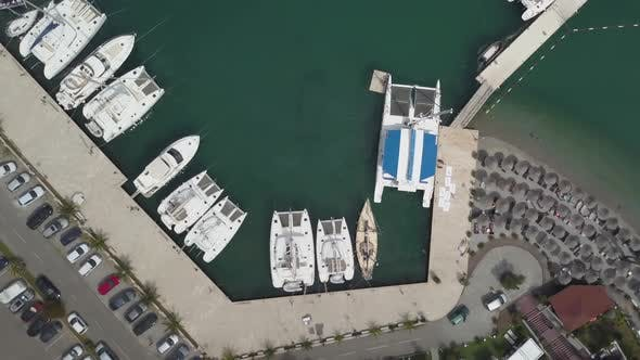 Cover Image for White Boats, Yachts and Catamarans Parked in Marina