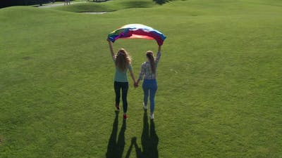 Drone View of Gay Couple Walking with Rainbow Flag