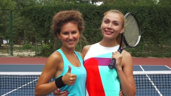 Thumbnail for Two Tennis Girls Smiling at Camera