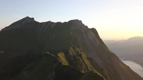 Thumbnail for Aerial Rotation Shot Of A Mountain Ridge In Switzerland During Sunrise