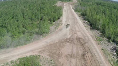Armoured vehicle on country road, aerial view