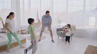 Cheerful Family Enjoying Indoor Gaming Activity