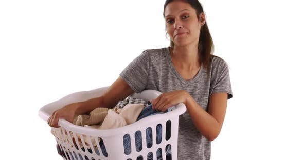 Thumbnail for Cheerful young woman holding basket of clean clothes on white background