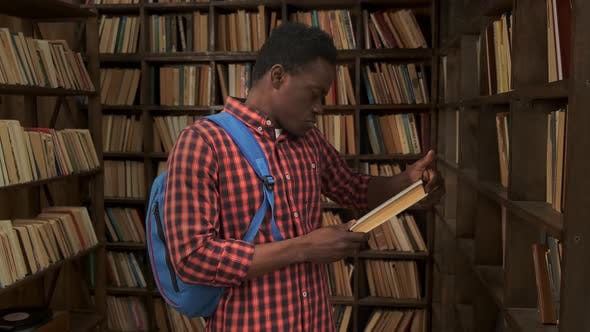 African American Young Student Studying at the School University Library