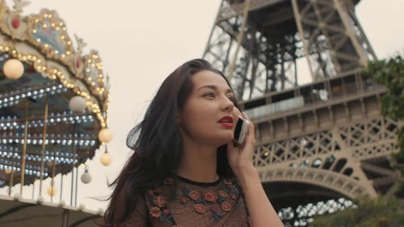 Thumbnail for Happy Travel Woman Talking on Phone Near the Eiffel Tower and Carousel, Paris, France