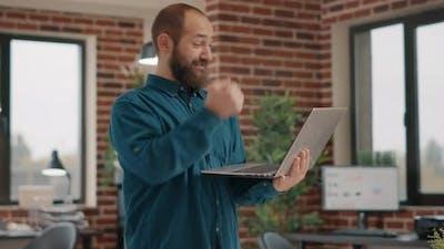 Happy Man Enjoying Satisfaction After Reading Good News