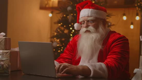 Thumbnail for Santa Claus Holding Gift Box Typing Keyboard Kid Talking To Child Greeting on Merry Christmas, Happy