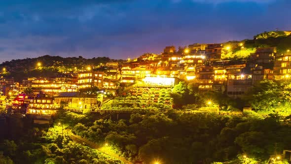day to night time lapse of Jiufen village with mountain in raining day, Taiwan