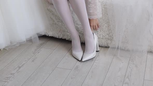 Woman Put on Wearing Wedding Shoes. Bridal Footwear, Morning Dressing Before Ceremony. Slim Legs