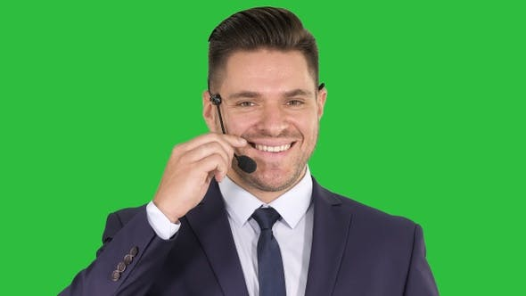 Thumbnail for Handsome businessman with headset looking into camera and