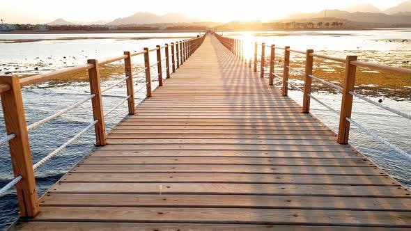 Cover Image for Beautiful Sunset Over the Ocean and Long Wooden Pier