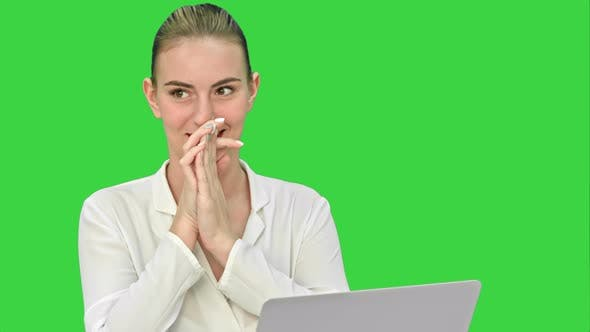 Thumbnail for Successful Young Businesswoman Working on Laptop, Writing Down Ideas and Smiling on a Green Screen