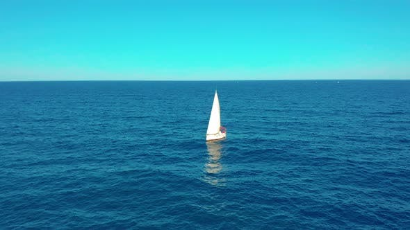 Cover Image for Aerial View. Yacht Sailing on Opened Sea. Yachting with Sails Up at Windy Day.