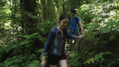 Asian Couple Hikers Hiking