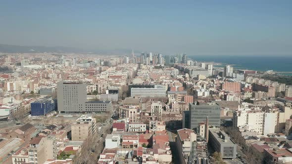 Thumbnail for AERIAL: Barcelona Wide Drone Shot of City Towards Skyline Cityscape